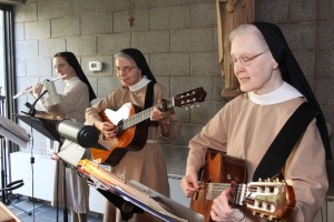 Sr. Anne (flute), Sr. Jean and Sr. Evelyn (guitars) playing for the Celebration of the Eucharist