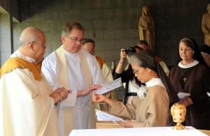 Msgr. Ramon blessing Sr. Maria Eden's profession ring